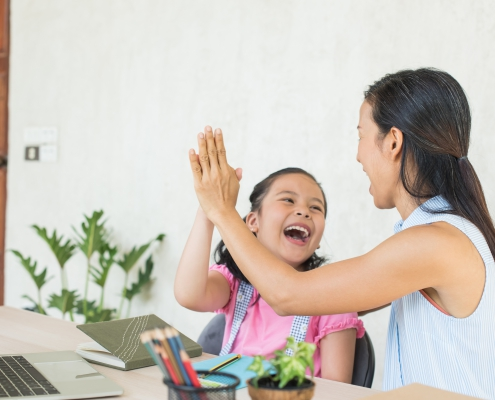 Homeschooling mother and daughter